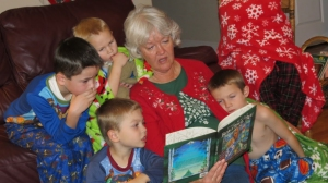 gramma reading a story to kids at Christmas